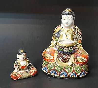 Pair Of Glazed Porcelain Satsuma Budas. Early Twentieth Century.
