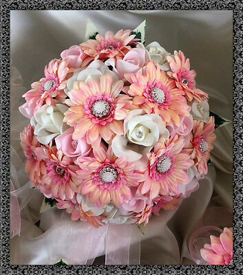 Brides wedding bouquet  artificial pink gerberas and roses with jeweled centres