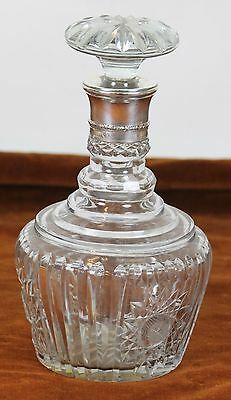 Liquor Bottle In Carved Glass. Neck Silver. Circa 1960.
