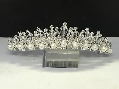 Beautiful tiara in silver colour with pearl and crystal rhinestones