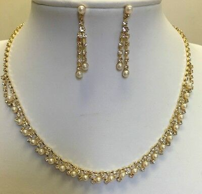 Bridal necklace and earrings set in gold colour with pearl and rhinestones