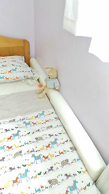 The Acosy Wall Wedge™ Stops Dummies & blankets falling under the bed!
