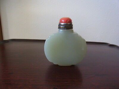A  Carved Pale White Jade Snuff Bottle