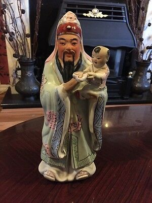 Fabulous Oriental Figure Of A Man Holding A Child