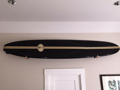 Paddle board wall racks
