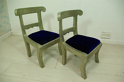 Indian white metal embossed children's chairs with velvet seating pads.