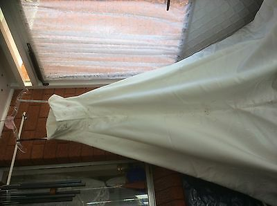 Pre loved wedding dress ivory with long trains.