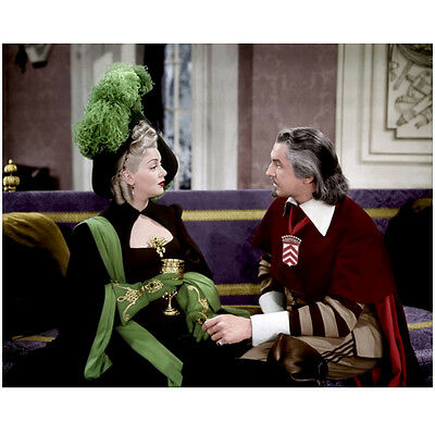 Lana Turner Seated in Green and Black Attire with Man 8 x 10 Inch Photo
