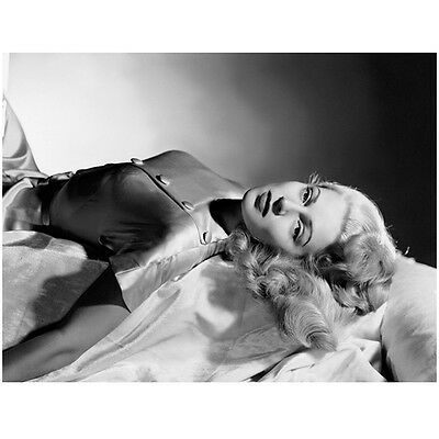 Lana Turner Laying on Back Looking On 8 x 10 Inch Photo