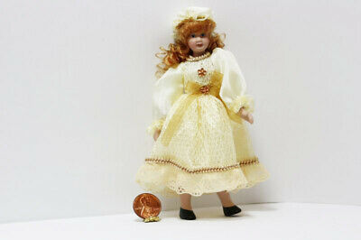 Dollhouse Miniature Girl  Doll in a Cream Satin and Beige Dress