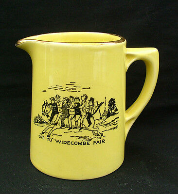 Small yellow jug decorated with Widecombe Fair verse and print
