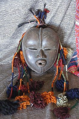Old African Carved Wooden Mask  …with colourful adornment