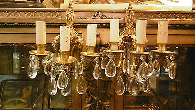 Antique Pair of European French bronze wall sconces and crystals 3 lights.
