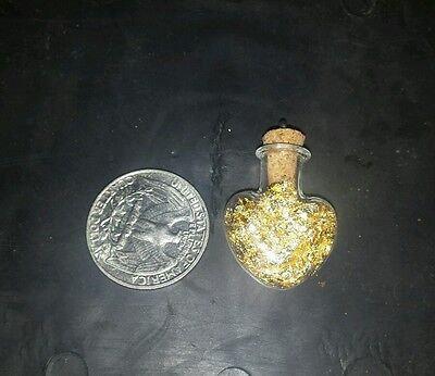 Glass heart shaped pendant filled with 24kt  gold leaf! $! $! $!
