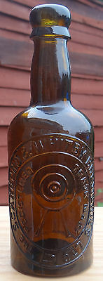 EMBOSSED:PICTORIAL ARCHERY TARGET TRADE MARK BOTTLE Circ:1920.STUNNINGCOLOR