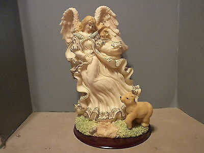 Angelwith Yellow Dress Holding A Dove With Dog On A Base
