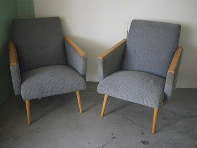 pair of blueish grey retro vintage designer chairs with cool wooden rests