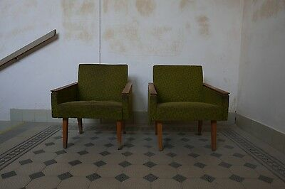 pair of green lounge chairs