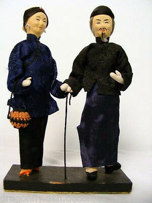 Vintage Chinese Elders Old Man and Old Woman Pair of Dolls on Wood Stand