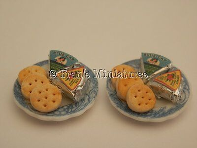 Dolls house food: Cheese triangles and crackers for two  -By Fran