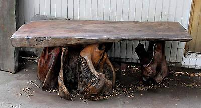 Table with tree trunk legs