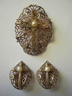 Vintage filigreed gold tone brooch, cross with faux pearl, matching clip earring