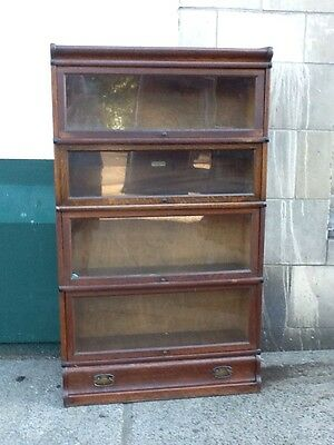 globe wernicke four section bookcase with draw