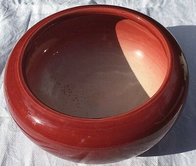 Attractive 9 inch Red Bretby bowl with bled white interior.