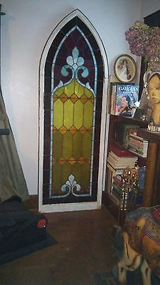 Nearly 8 Ft Arched Gothic stained glass window beautiful purple yellow and blues