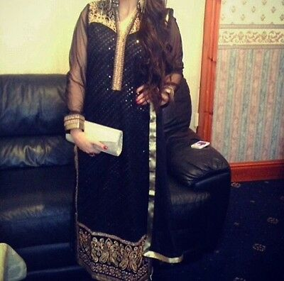 Size small Asian black and gold outfit