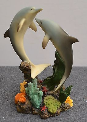 "Dolphins swimming over coral figurine resin 8"" high"