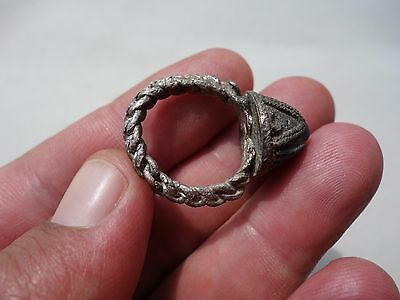 ancient Middle Ages copper-silvered ring,twisted loop,with blue glass decoration