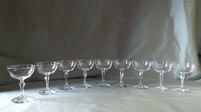 9 antique Victorian crystal champagne glasses on faceted stem
