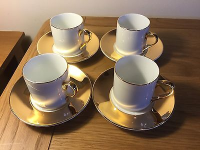 Set Of 4 White And Gold Coffee Cups And Saucers