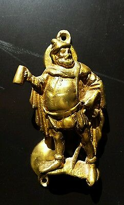 Vintage brass door knocker, medieval gentleman with mug