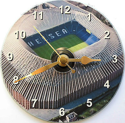 Football cd clock with Chelsea's new Stamford Bridge stadium on the face.