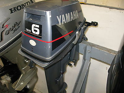 6 hp Yamaha  outboard 2 stroke long shaft remote control  warranty boat engine