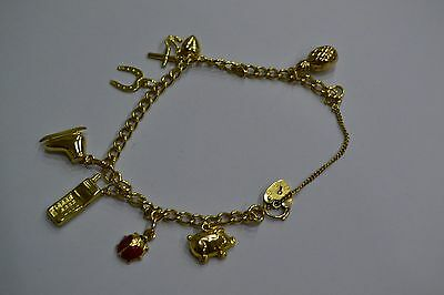 Ladies 9Ct Gold Charm Bracelet & 7 Charms