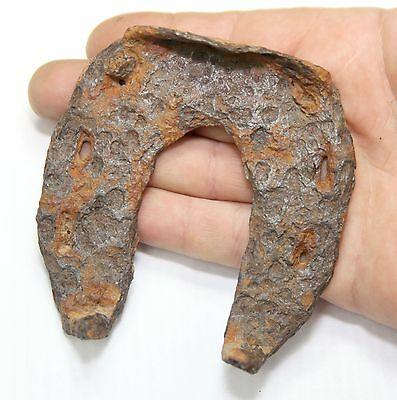 ANCIENT medieval iron horseshoe . From northern Europe