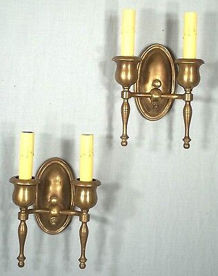 PAIR OF ANTIQUE EARLY 20th CENTURY DOUBLE ARM OVAL BACK BRASS SCONCES