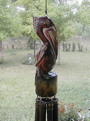Cottage Style Solid Wood Hand Carved Mahogany Stained Pelican Bamboo Wind Chime
