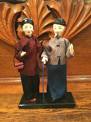 VTG Asian Couple Dolls In Silk Clothing In Wood Stand