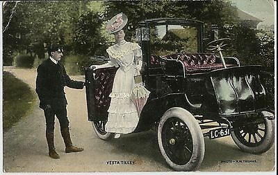 Vesta Tilley and early car with chauffeur on colour photo postcard sent in 1907