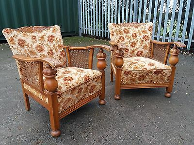A Matching Pair Of Vintage Bergere Armchairs With Carved Details
