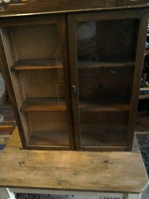 large vintage wooden wall glass fronted cabinet