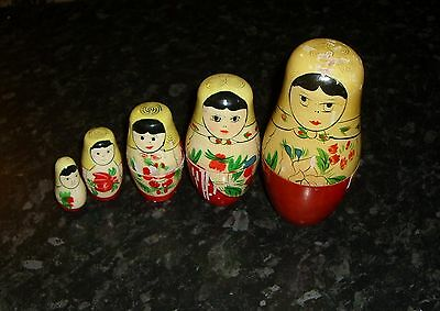 Vintage RUSSIAN DOLL SET of 5- Traditional Design 6 tall approx -