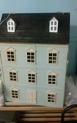 Dolls house with furniture and people