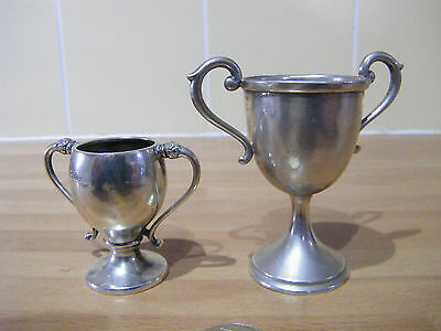 silver trophies the big one is .800 the small one is British sterling not scrap