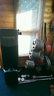 149kg cast iron weights, rack and bars