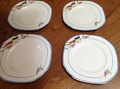 set of four grindley china hand painted side plates